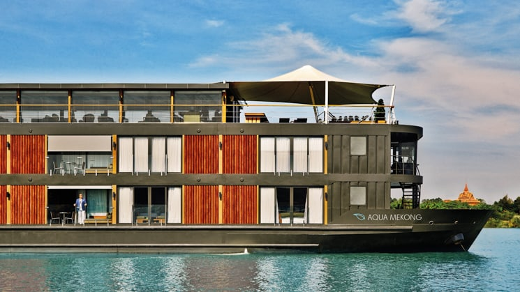 Starboard side of the luxury Aqua Mekong Amazon riverboat with large windows and top deck lounge.