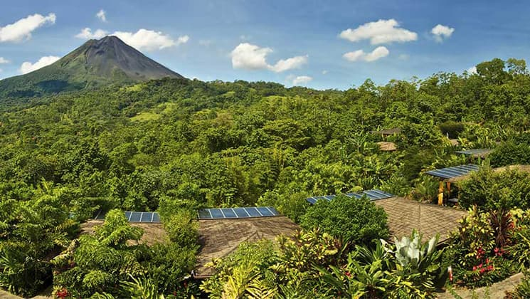 A panoramic view of the lush jungle and the Arenal Volcano National Park, adjacent to the Nayara Hotel, Spa & Gardens, a luxury boutique hotel in Costa Rica
