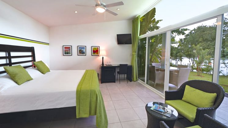 A guest room with a queen bed and sliding glass doors has a panoramic view at the Bocas del Mar hotel in Panama