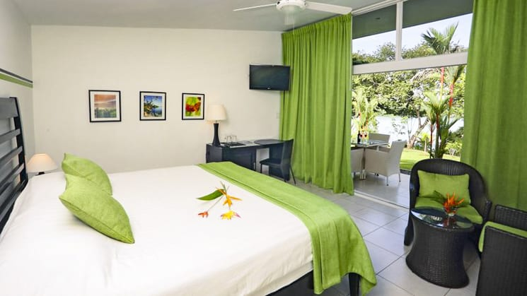 Green curtains and blankets brighten up the contemporary bungalows at the Bocas del Mar Hotel in Panama