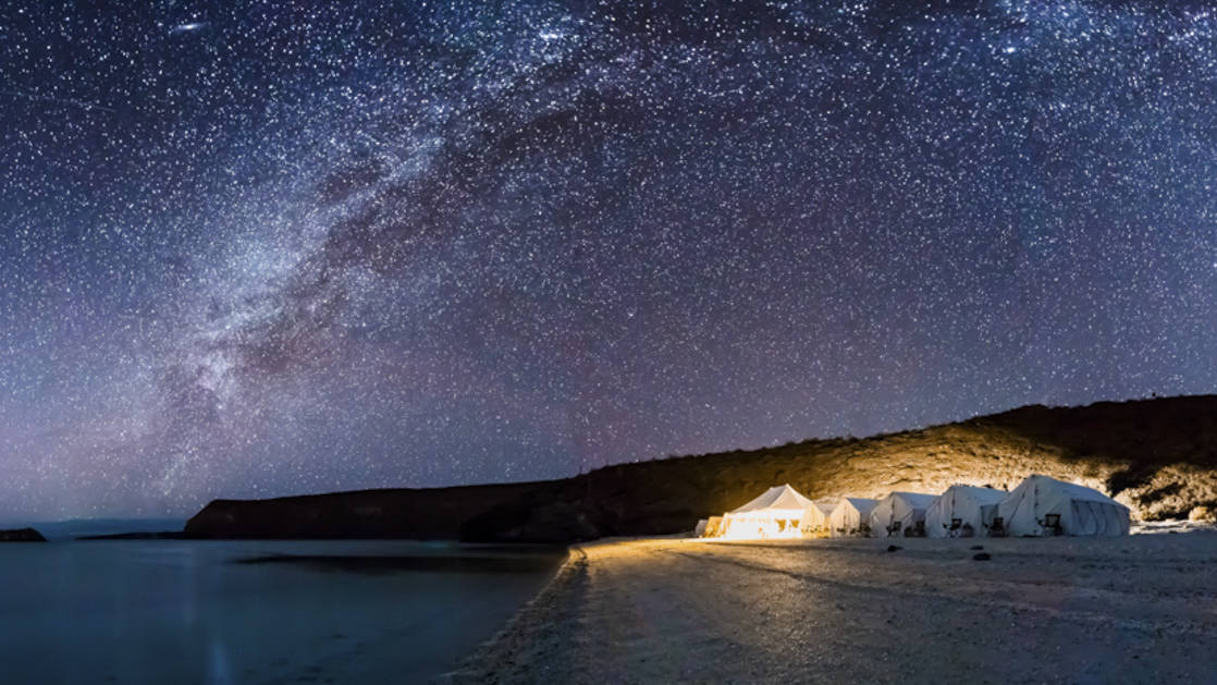 Camp Cecil is lit up at night, with a beach for stargazing at the Milky Way, on the pristine and wildly beautiful Isla Espiritu Santo, part of a National Marine Park and UNESCO World Heritage Site.
