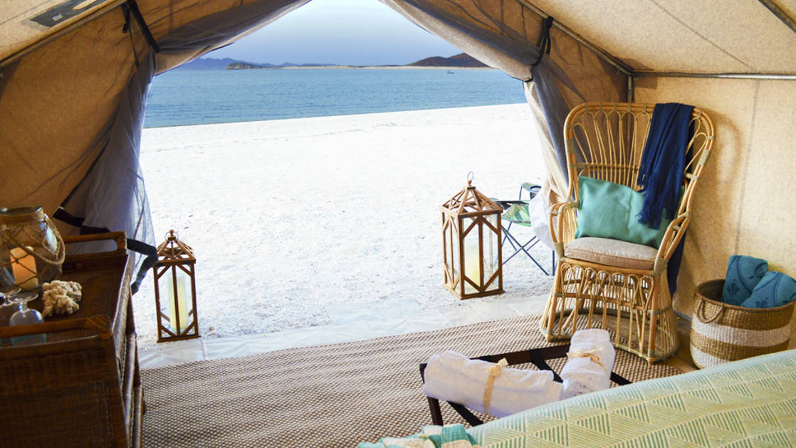 The ocean and a white sand beach are just outside the glamping tents at Camp Cecil on Isla Espiritu Santo