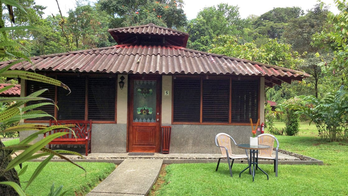 A table for two on the grass outside a deluxe bungalow at Casa Corcovado Jungle Lodge in Costa Rica