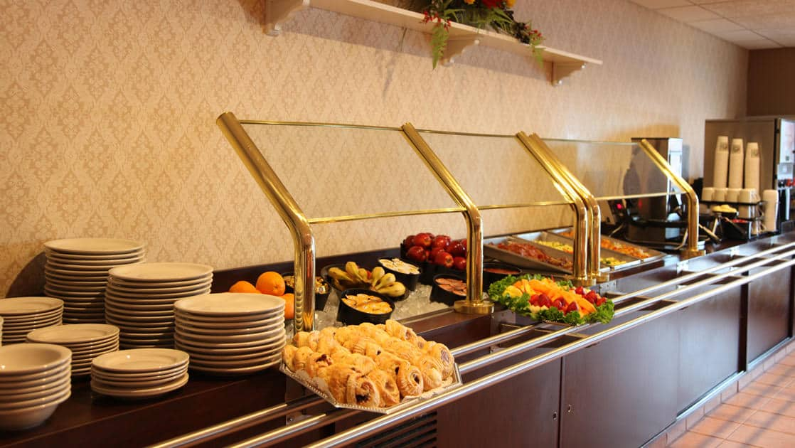 Breakfast buffet with fresh fruit and pastries at Clarion Suites in Anchorage