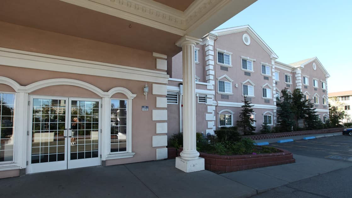 Main entrance and ample parking outside Clarion Suites in Anchorage