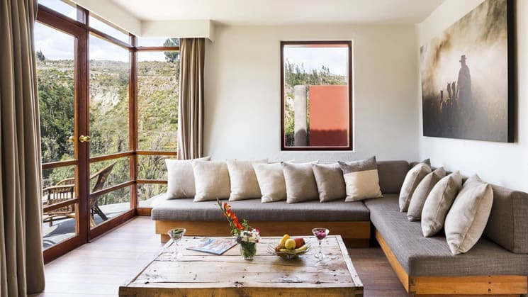 "Huge ""L"" couch with 180-degree views in the Panorama Suite at Colca Lodge in Peru"