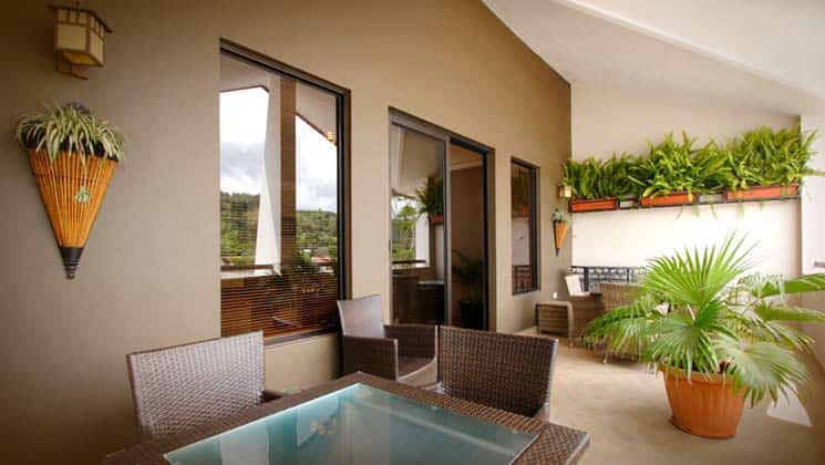 outdoor area with table, chairs and large windows with greenery in the background at hotel ladera in panama