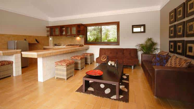 large kitchen area with wood floors and large countertops at hotel ladera in panama