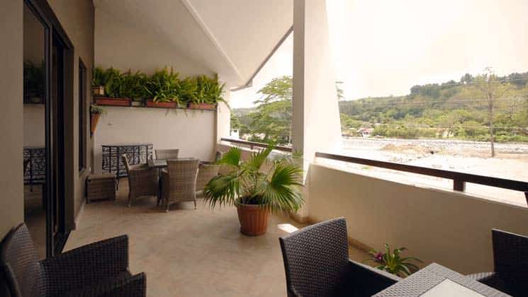 patio area with chairs and potted plants overlooking the town at hotel ladera in panama