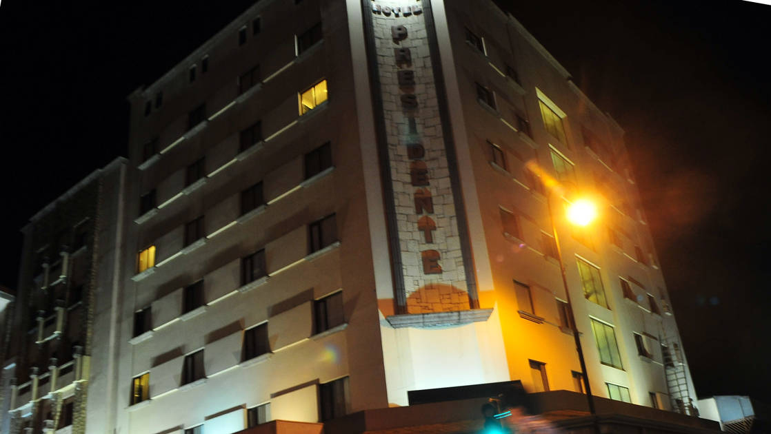 Lit up at night, the exterior of the four-star Hotel Presidente, in downtown San José, Costa Rica, a few blocks from the city's most important cultural and historical landmarks.