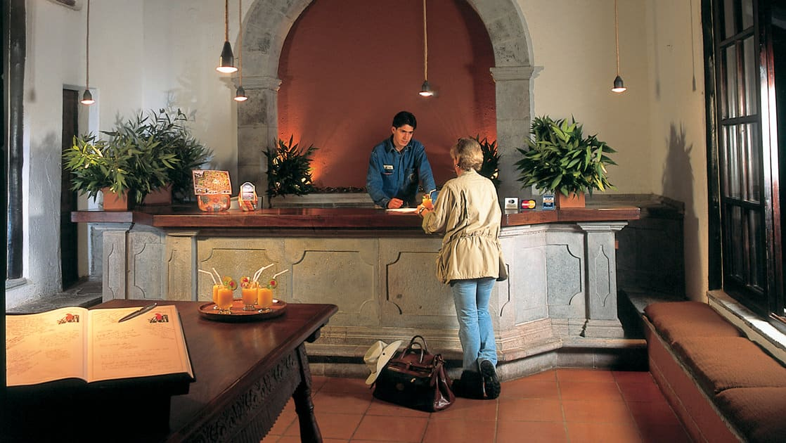 A guest checks in at the front desk of the Inkaterra Machu Picchu Pueblo Hotel, a National Geographic Unique Lodge of the World, in Peru.