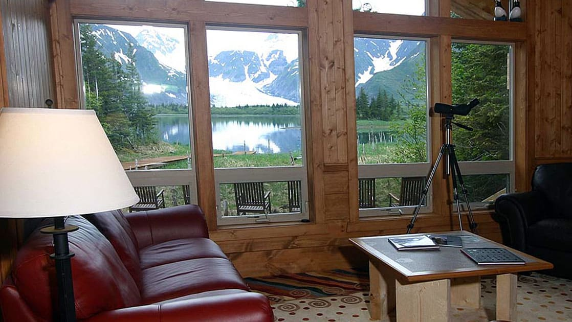 The view just beyond the windows in the lounge is all mountains, glaciers, and forest at the Kenai Fjords Glacier Lodge in Alaska