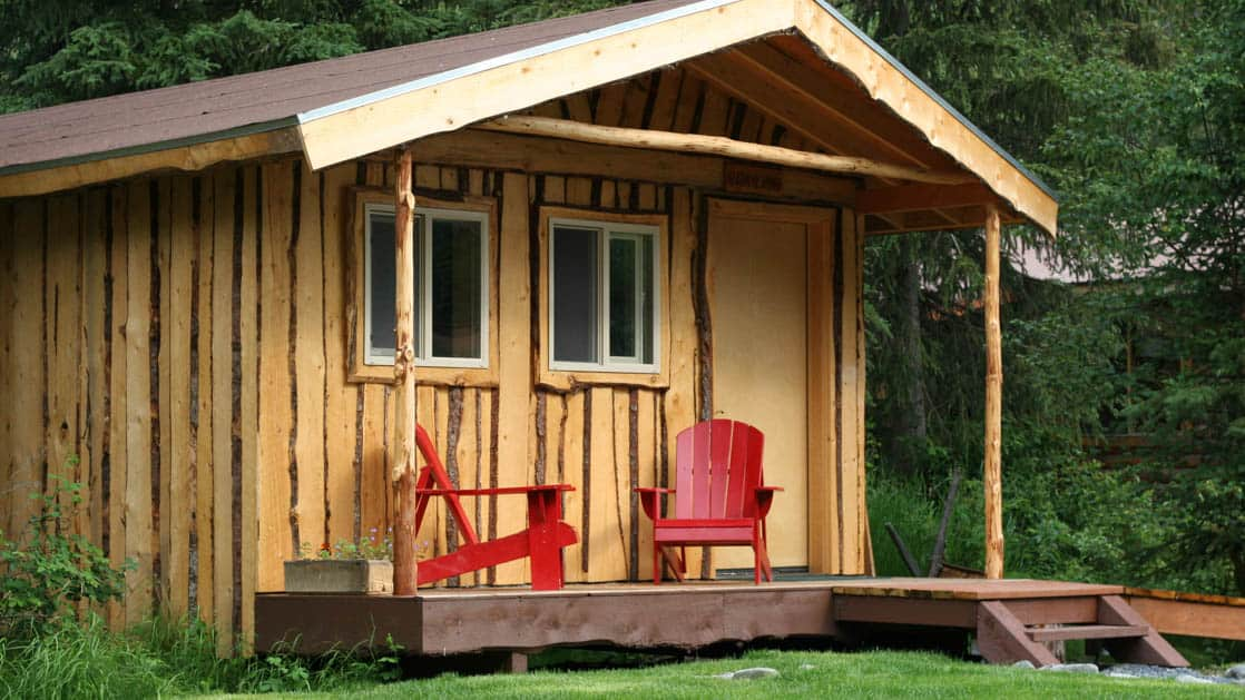 One of the private guest wooden cabins at the Kenai Riverside Lodge, a fishing and nature retreat in Alaska, offers an ideal home base for adventure