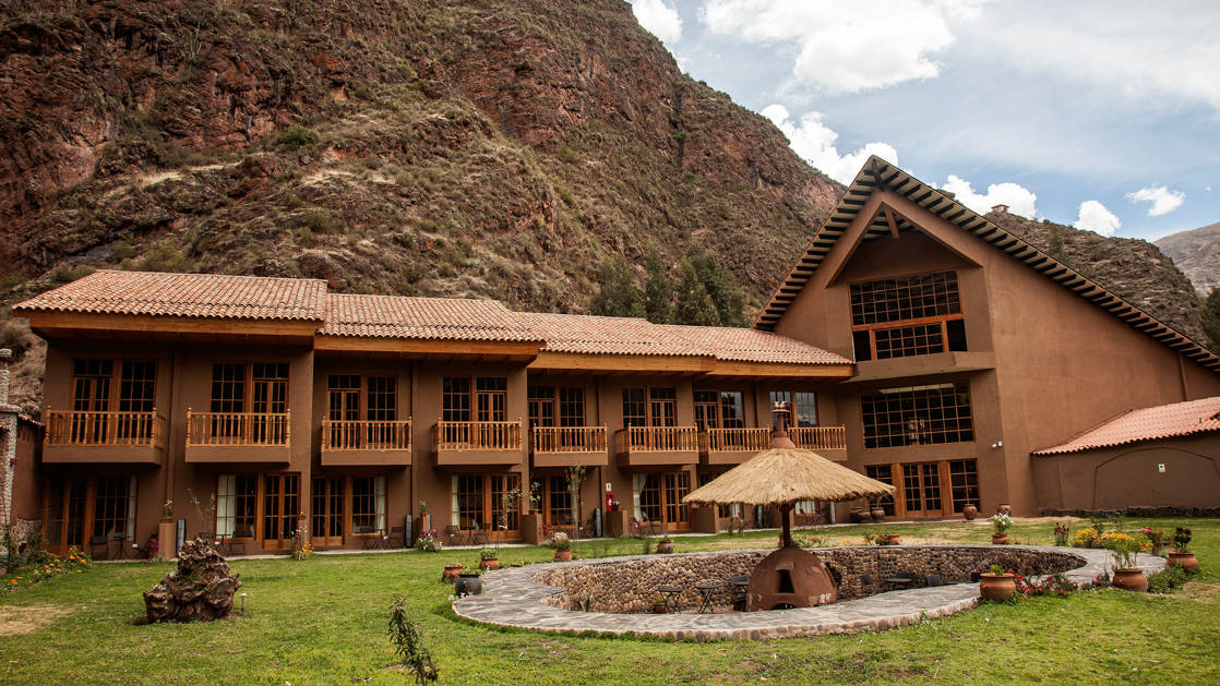 The exterior of the mountain lodges in Peru's Lares Region, a sustainable accommodation