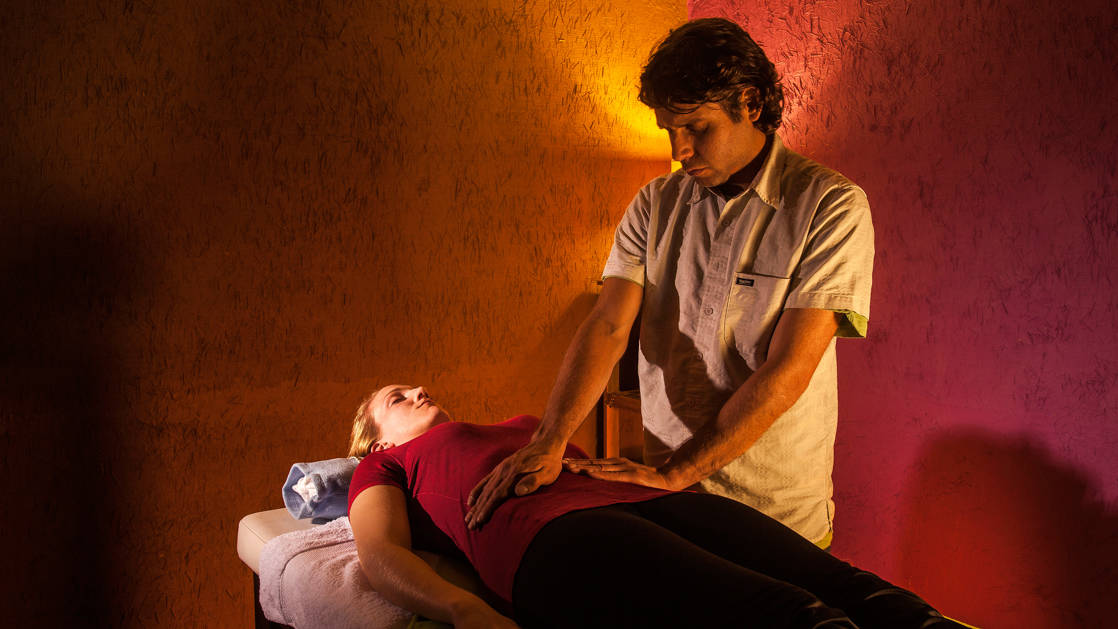 A trekker receives a massage and spa treatment at the mountain lodges in Peru's lares region, a sustainable accommodation