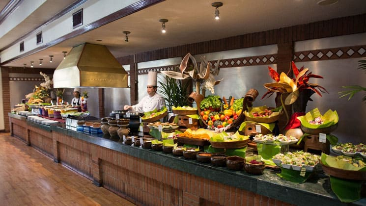 buffet line with colorful food and chefs behind the counter at the las americas hotel in guatemala
