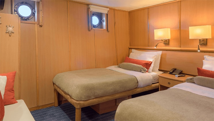 Galapagos Legend Standard Plus twin bed cabin with portholes