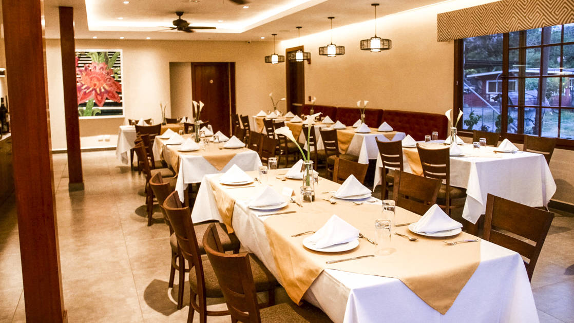 The dining room with tables set for a gourmet meal made with fresh local ingredients at the family-owned Los Brezos Hotel, near the Baru Volcano in Panama
