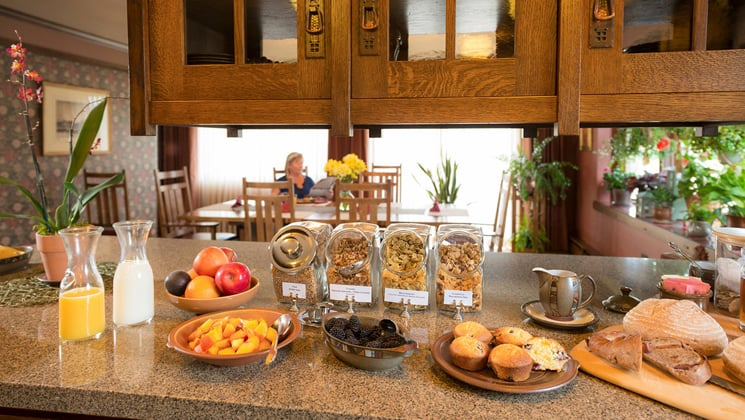 The breakfast buffet features orange juice, milk, cereal, and fresh bread at the Parkside Guest House, a family-owned hotel in Anchorage Alaska