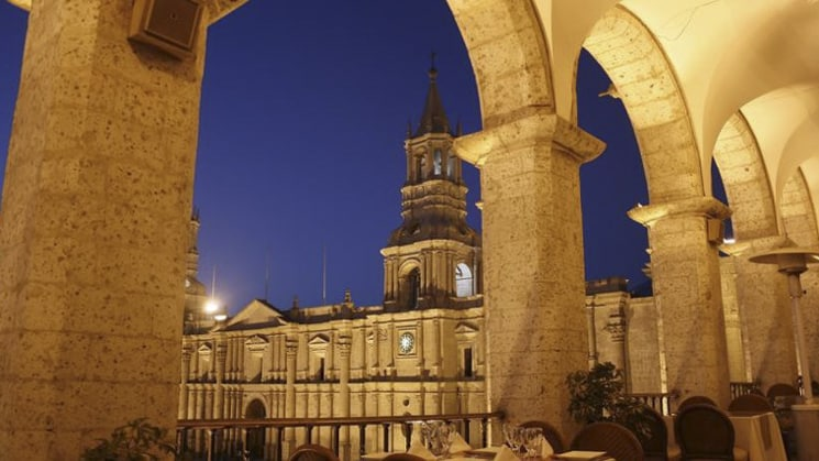 A view beneath an arched pathway of Sonesta Posada Del Inca Arequipa, a renovated hotel in the heart of the city