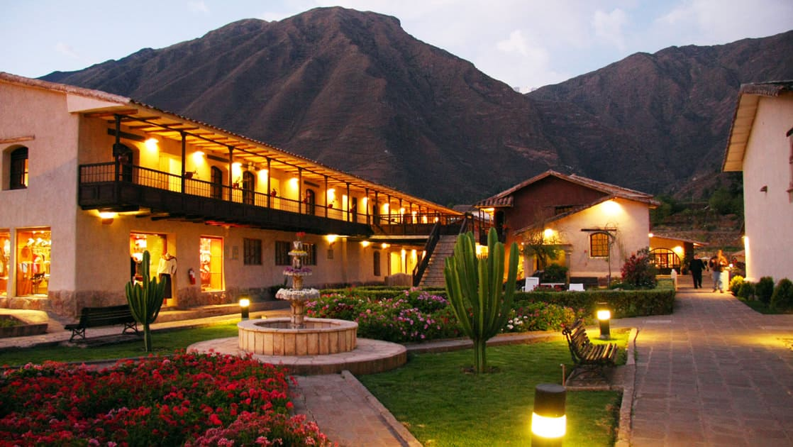 Lights illuminate the courtyard, gardens, and fountains at Sonesta Posadas Del Inca Sacred Valley Yucay, located ini Peru and only a train ride from Machu Picchu