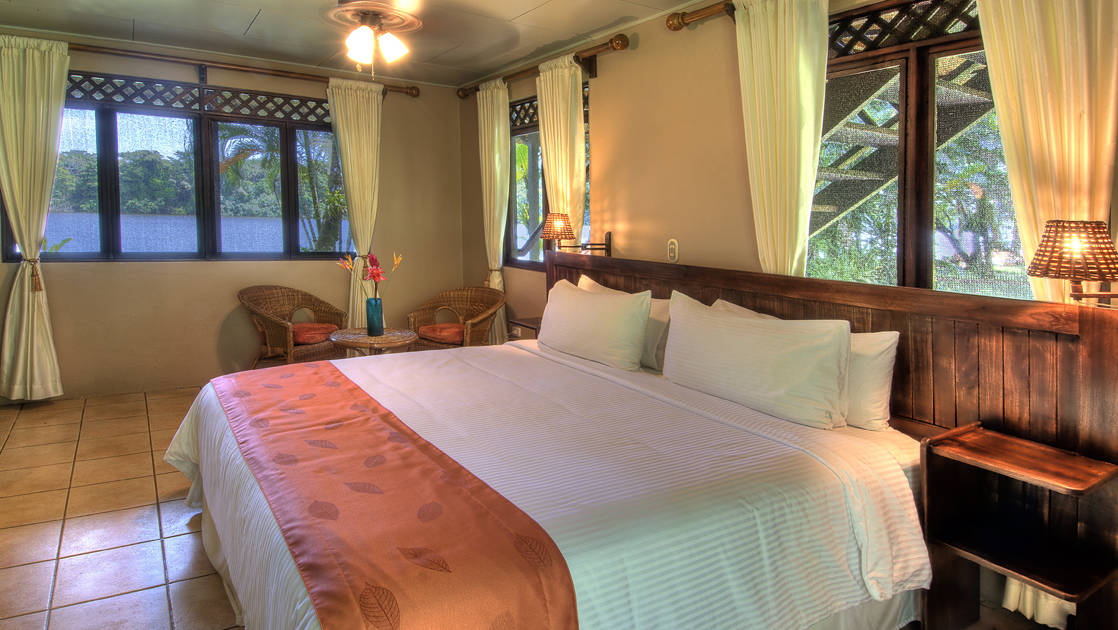 River View Downstairs Terrace Room with King Bed at Tortuga Lodge