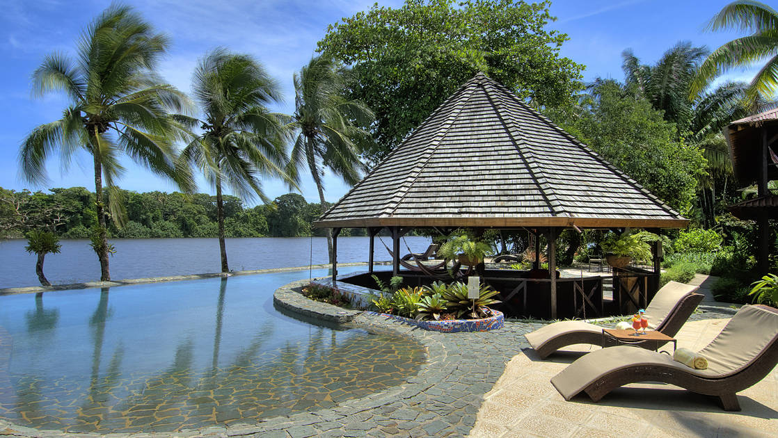 The pool at Tortuga Lodge, one of Costa Rica's most environmentally conscious resorts, is designed to blend into the river and features an eco-friendly purification system.