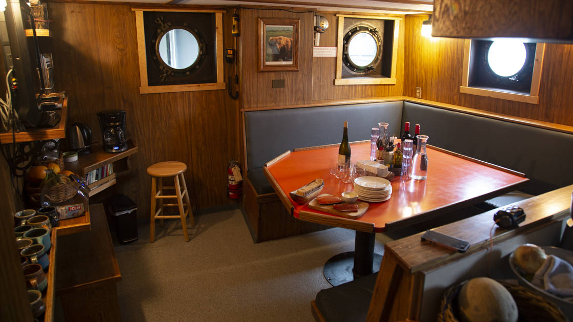 Dining table and bar area aboard Ursus.