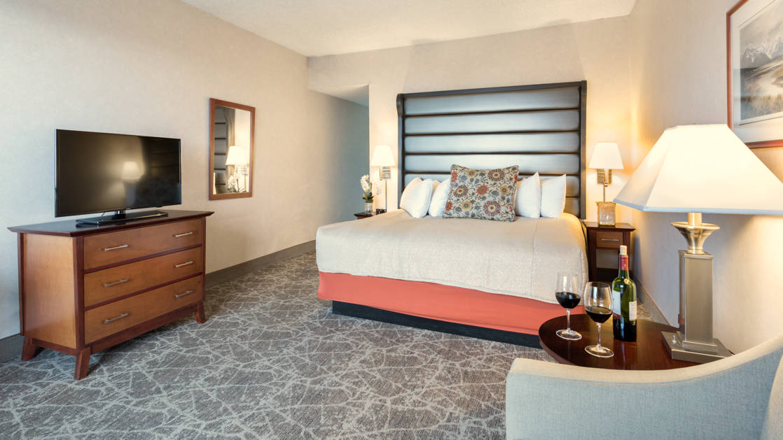 A standard room with a king-sized bed, television, and sitting area at the Westmark Anchorage, a downtown hotel that was recently renovated