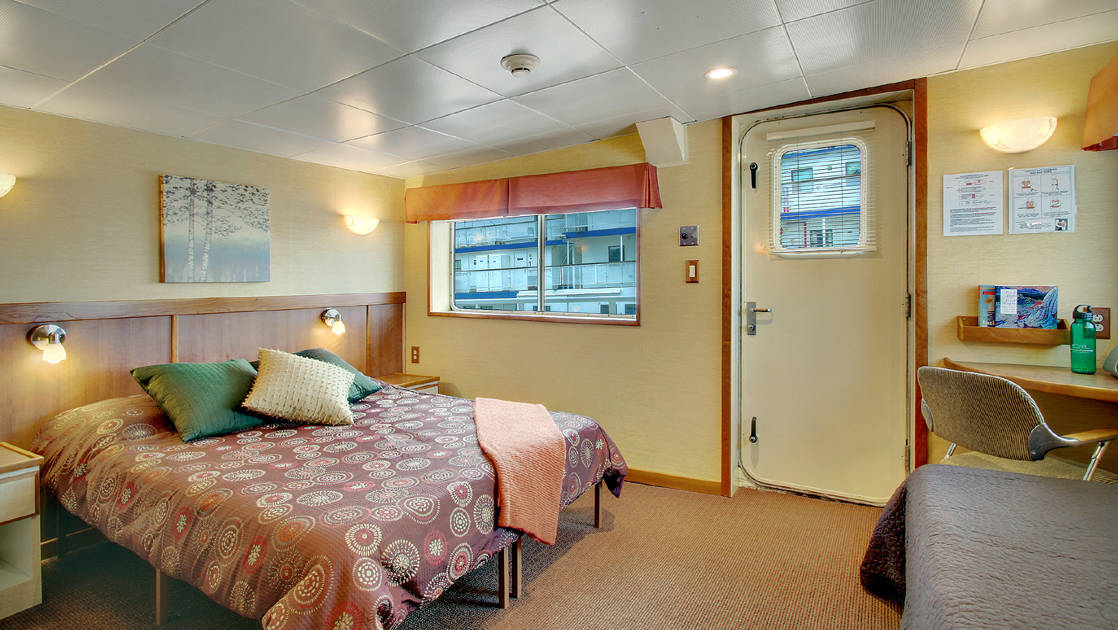 Explorer cabin with queen bed aboard Wilderness Discoverer