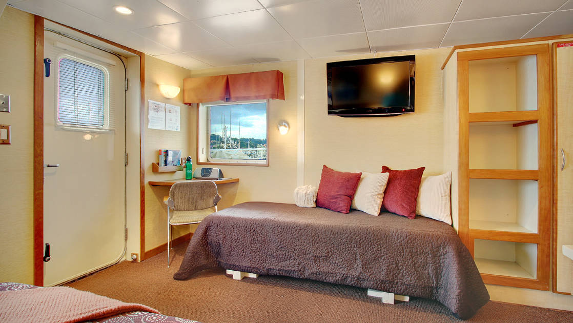 Day bed to accommodate a third person in the Explorer cabin aboard Wilderness Discoverer