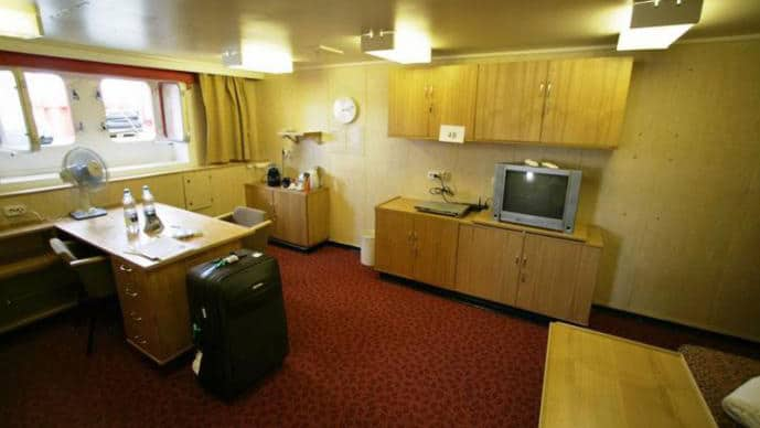 50 Years of Victory Arktika Suite with windows, desk, dresser, seating and double bed.