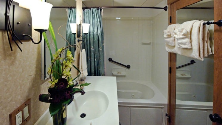 Safari Explorer Hawaii small ship commodore suite bathroom with full shower and vanity