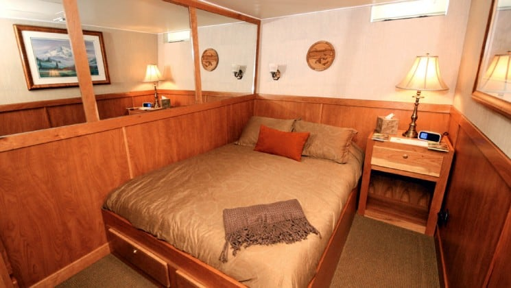 Mariner Stateroom with double bed aboard Safari Quest. Photo by: UnCruise
