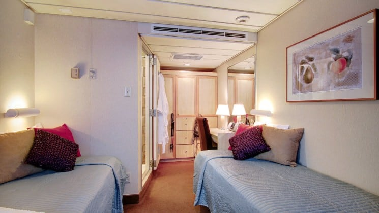 Safari Endeavour Alaska small ship Commander cabin with two beds and an adjoining room