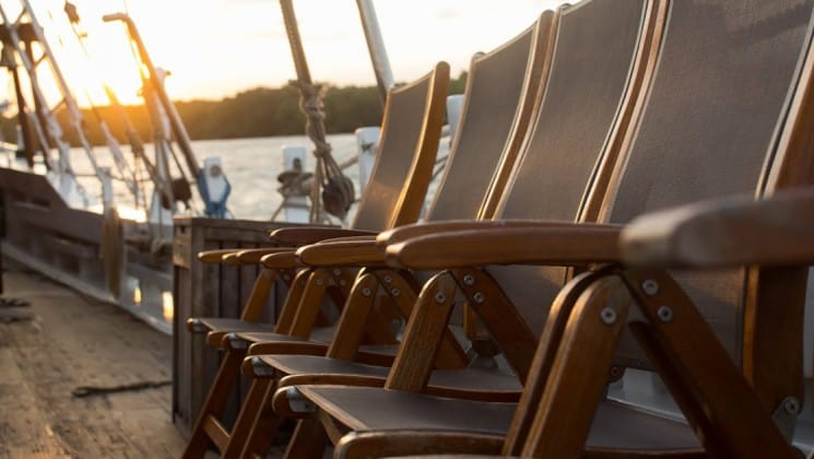 Katharina with chairs on the deck of the sailboat.