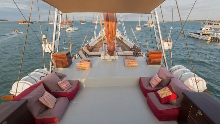 Katharina sailboat outdoor deck with couches, chairs and lounge chairs.