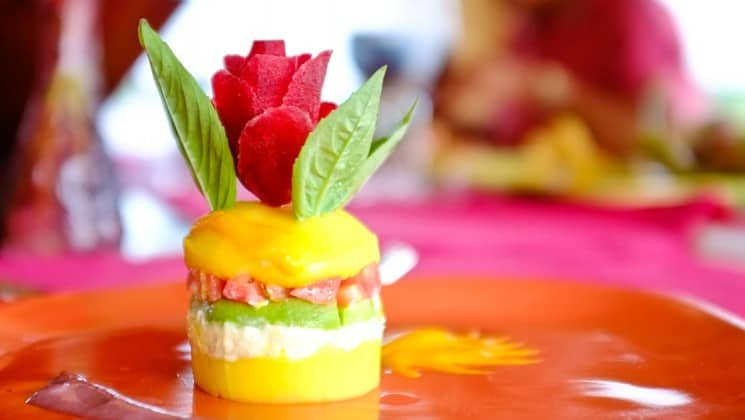 Colorful appetizer topped with flowers, prepared aboard Delfin II riverboat on Amazon River cruise