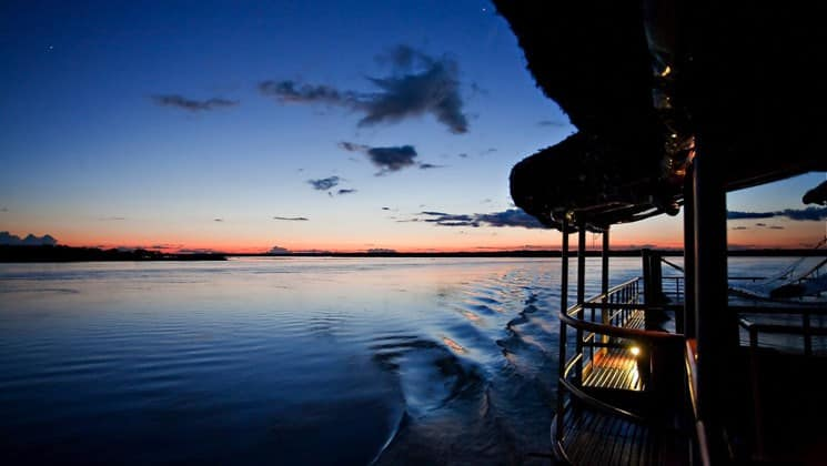 Starboard side of the Main Deck at twilight aboard Delfin II riverboat on Amazon River cruise