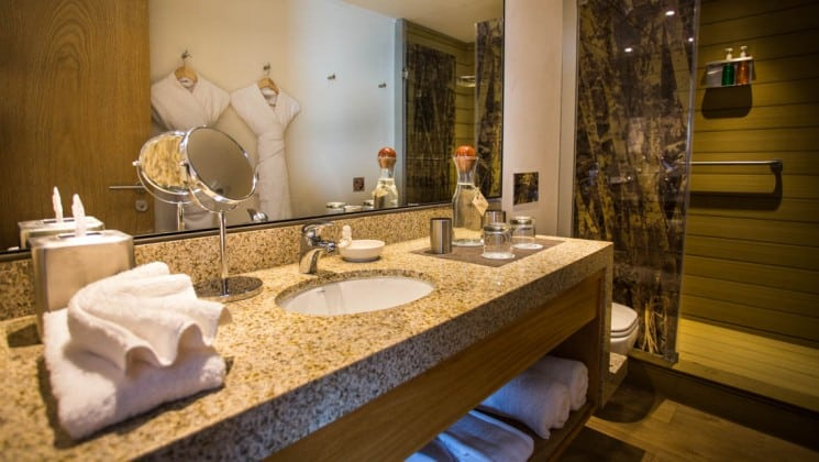 Shower, toilet, sink and mirror in bathroom of Suite aboard Delfin III riverboat on Amazon River cruise