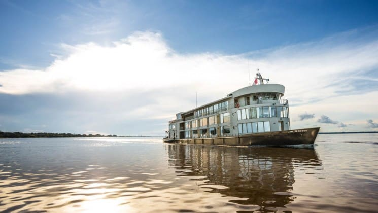 Exterior of bow and starboard side of Delfin III riverboat on Amazon River cruise