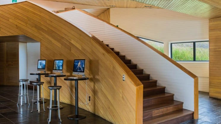 Three computer stations set up near the staircase in the lobby of Explora Patagonia Lodge in Chile