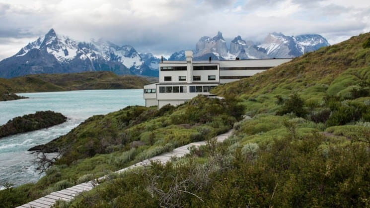 Exterior of Explora Patagonia Lodge in Chile, placed among mountains on the shores of Lake Pehoe