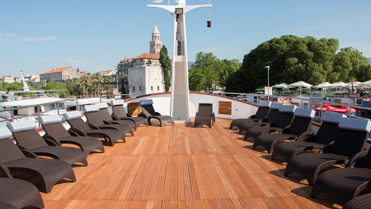 Fantazija deck on the bow with lounge chairs.