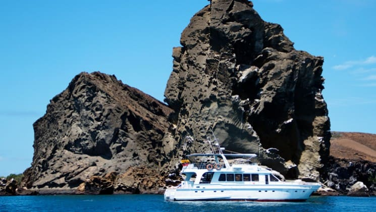 Finch Bay Eco Hotel's yacht, the Sea Lion, cruises the water near the hotel in the Galapagos Islands