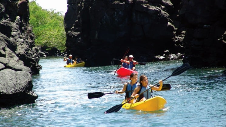 Kayakers float a narrow channel near Finch Bay Eco Hotel in the Galapagos Islands