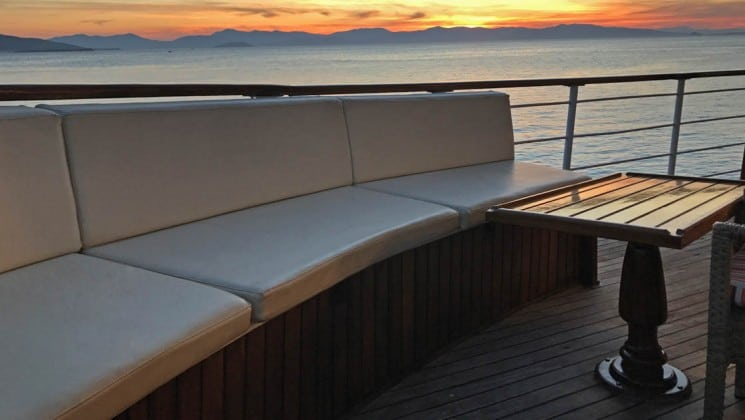 Galileo sailboat deck with banquette seating and table.