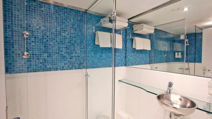 Harmony G yacht bathroom with shower, sink and glass counter top.