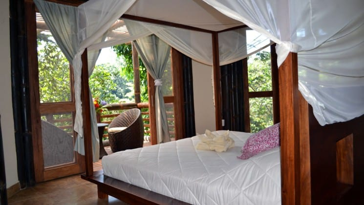 The Superior Suite at La Selva Amazon EcoLodge, a sustainable, luxury accommodation in the Ecuadorian Amazon basin, with a king-sized bed and a private balcony