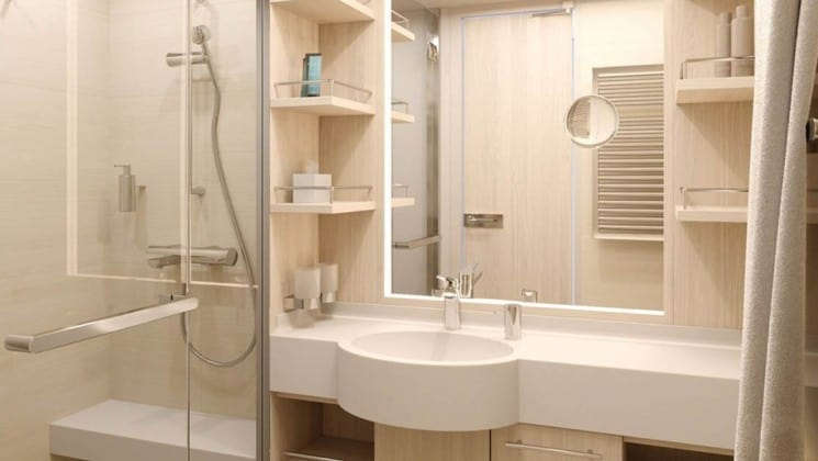Rendering of bathroom with shower, sink and large mirror aboard National Geographic Endurance polar expedition ship